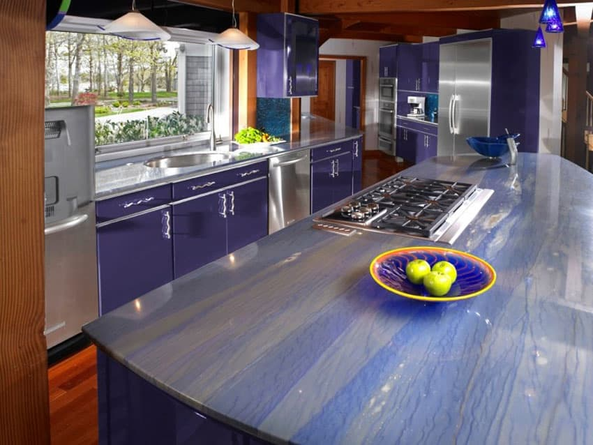 Modern purple galley kitchen with purple lights and counter