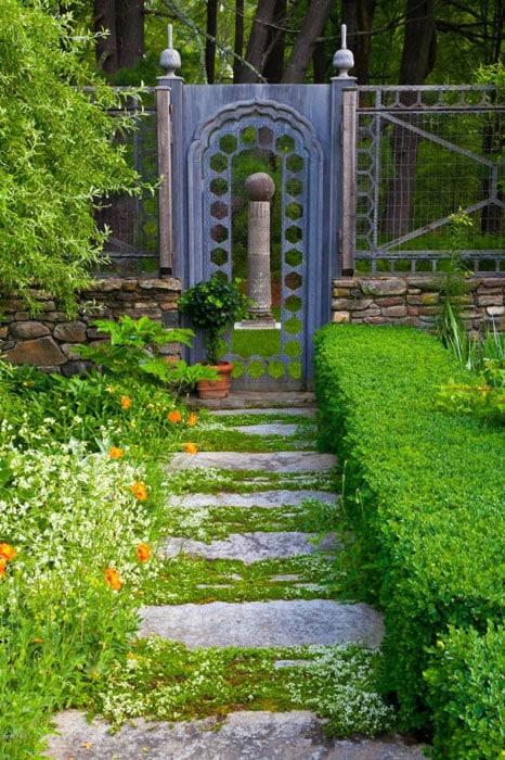 Rough stone path through garden to gate