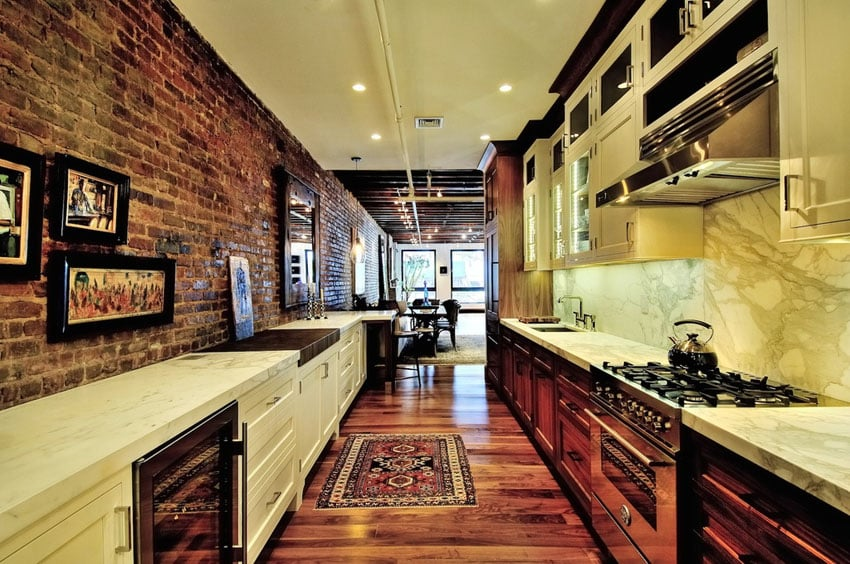 Rustic galley kitchen with brick accent wall