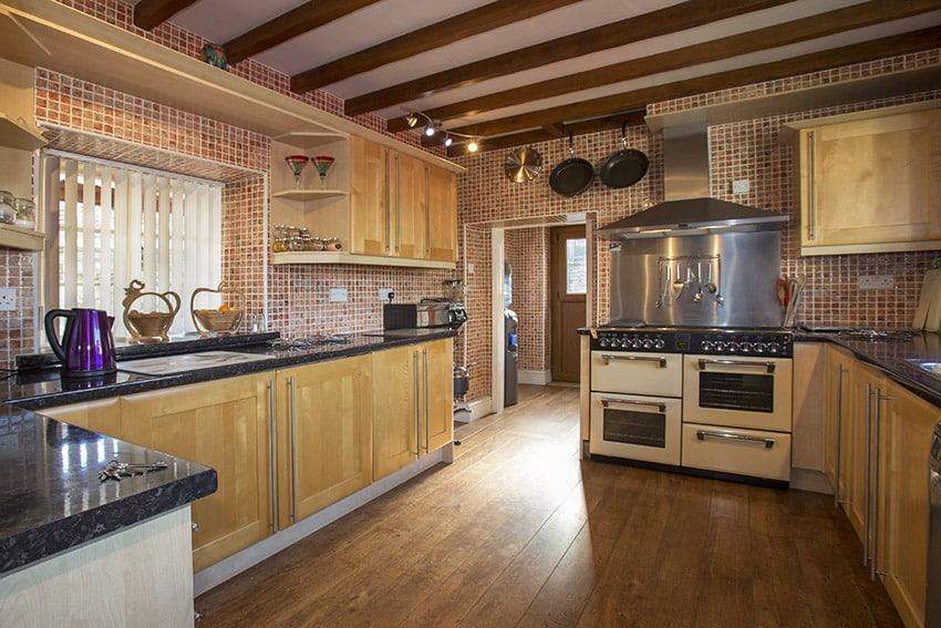 Rustic kitchen with exposed beams wood floors