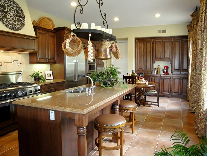 Rustic wood kitchen with large island and ceramic floor tiles