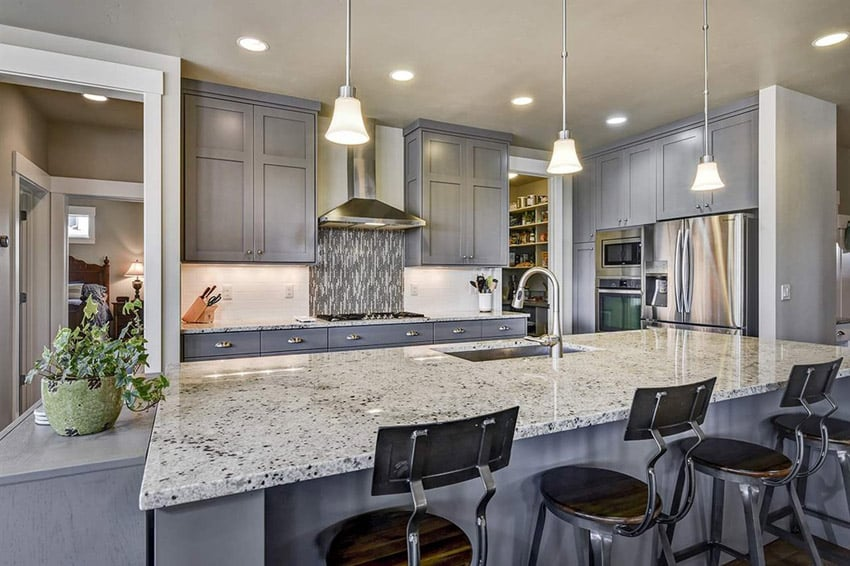 Small contemporary ktichen with snowfall granite counters