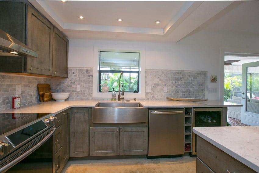 Small kitchen with bianco venatino marble countertops
