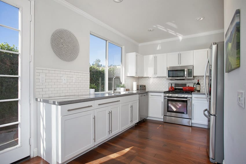 Small white kitchen with hardwood floors