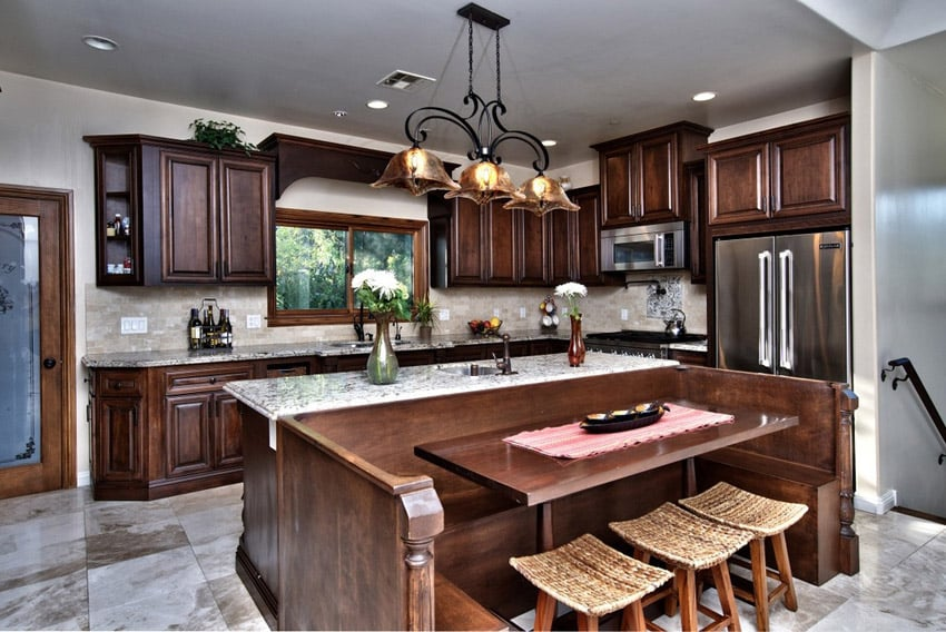 Traditional dark cabinet kitchen with damasco marble countertops