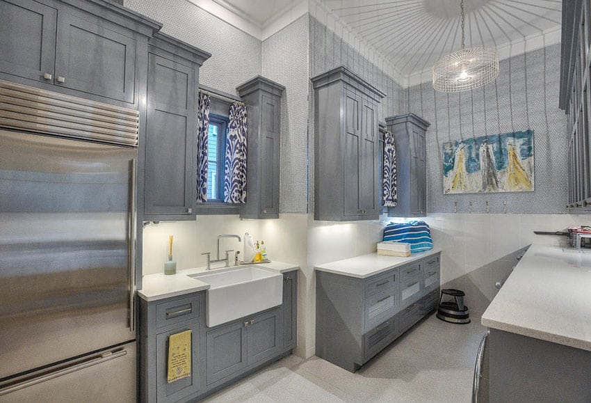 Traditional galley kitchen with gray cabinets and farmhouse sink