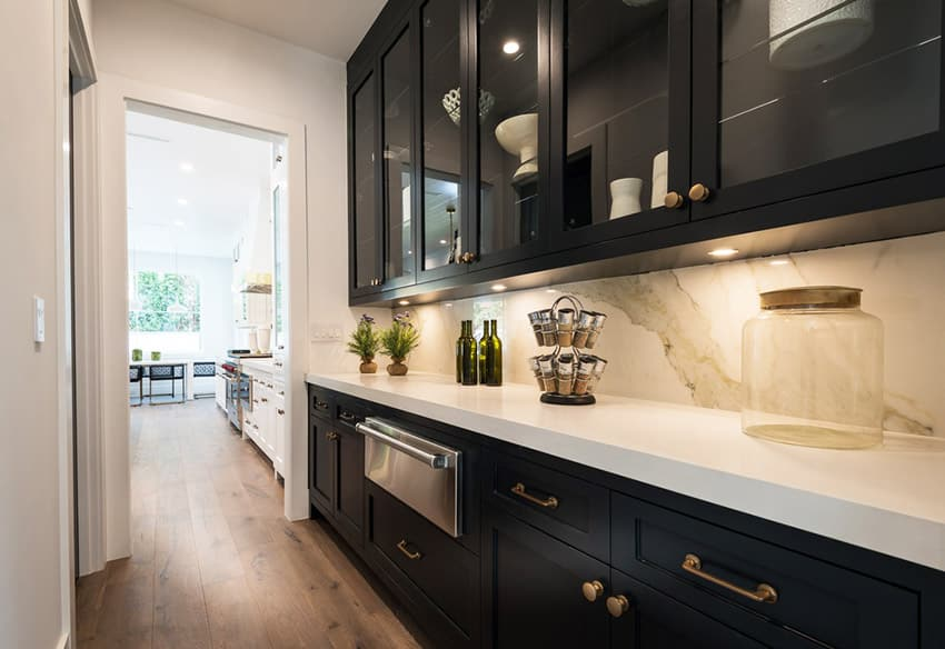 Traditional galley kitchen with white quartz counter