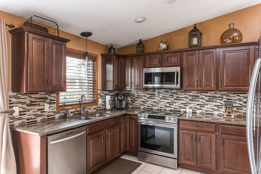 Traditional kitchen in corner l shape limestone floors