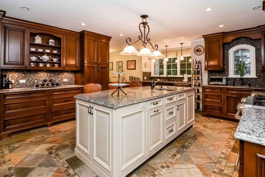 Traditional kitchen with cascade white quartz counters large island