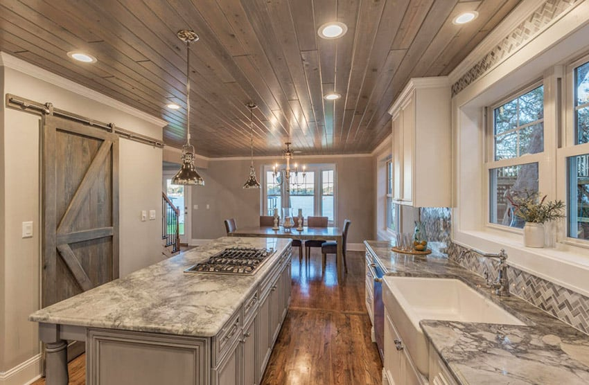 Traditional kitchen with emperador white marble countertops