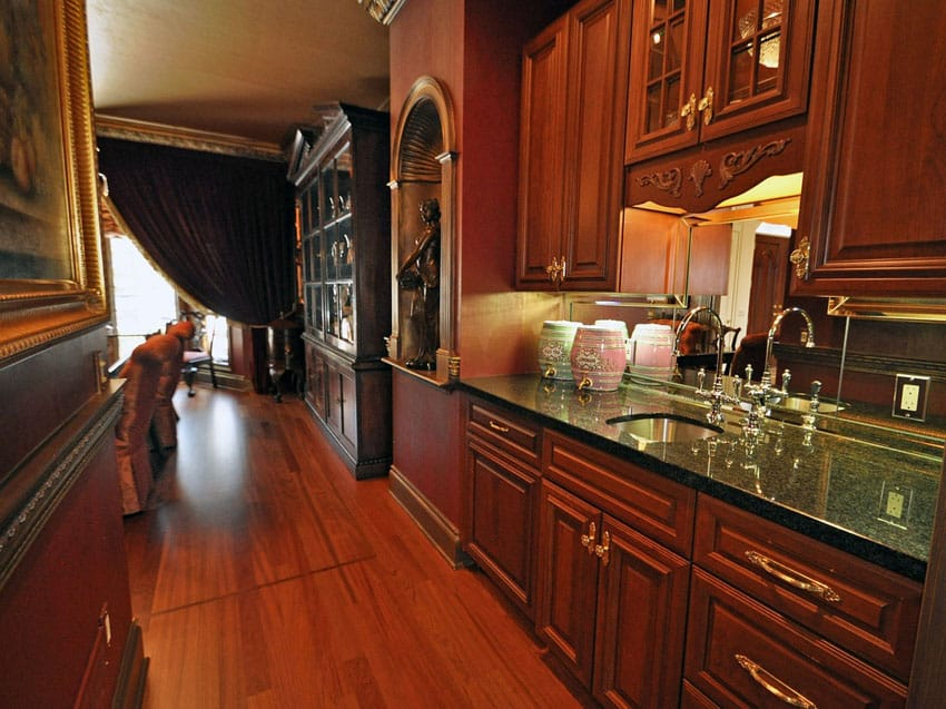 Traditional small galley kitchen with Cambrian black granite counters