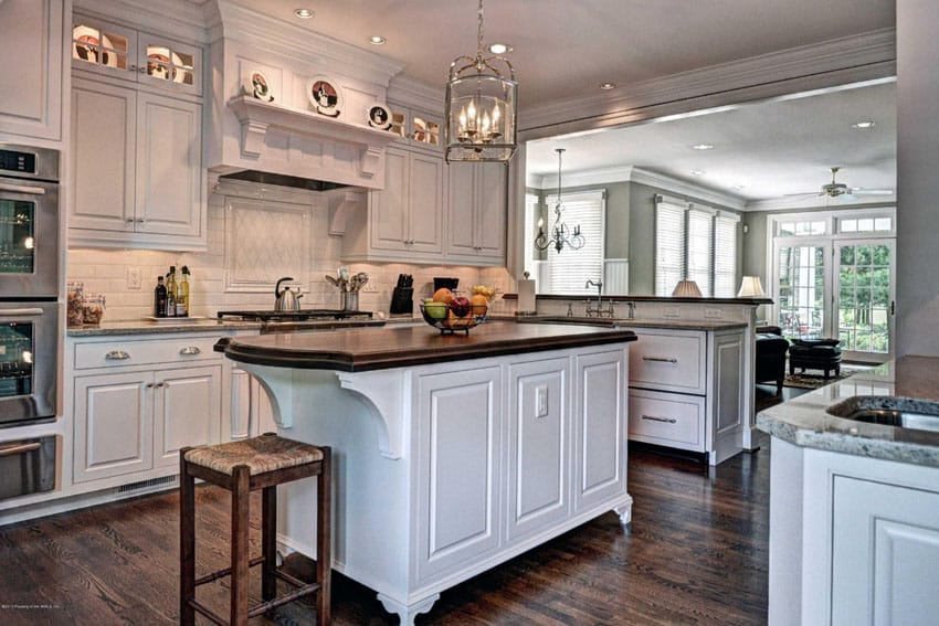 White decorative wood kitchen island with butcher block surface