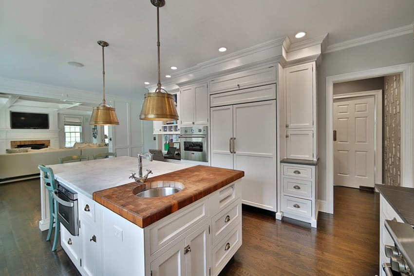 White kitchen with calacutta carrara marble counter from italy and mable butcher block counter