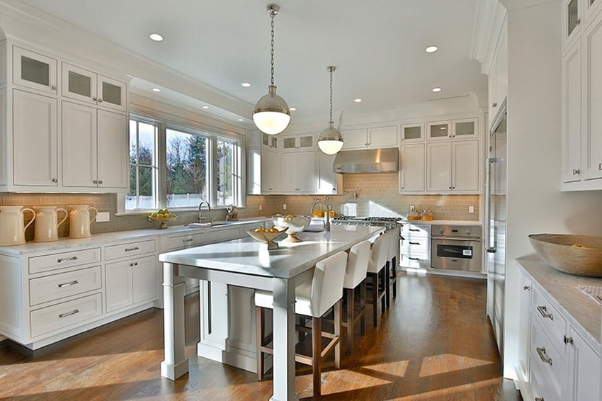 White kitchen with carrara white marble counters