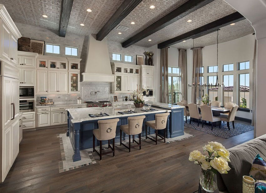 Amazing open concept kitchen with exposed beams white cabinets