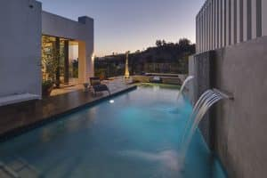 30 Swimming Pool Water Features (Waterfall Design Ideas)