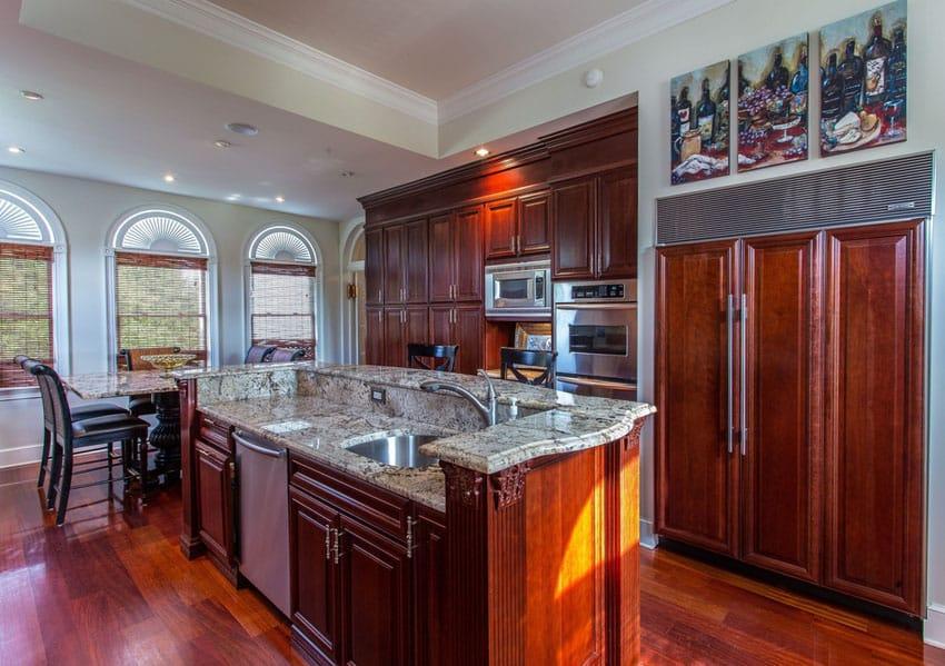 Classic wood kitchen with custom granite island