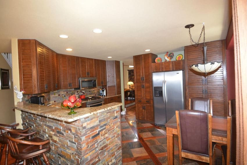Country kitchen with brick peninsula and granite counters
