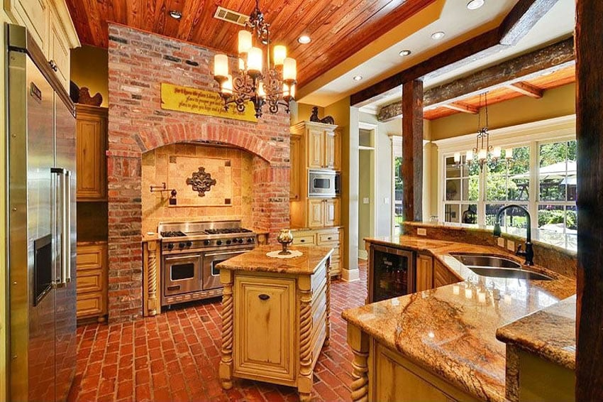Country kitchen with brick wall brick floors and limestone countertops