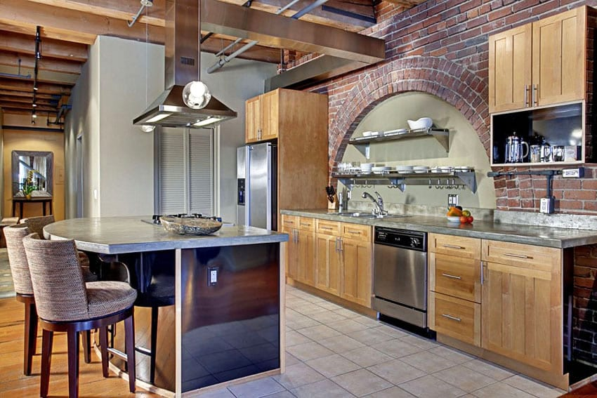 Craftsman kitchen with arched brick wall above countertop