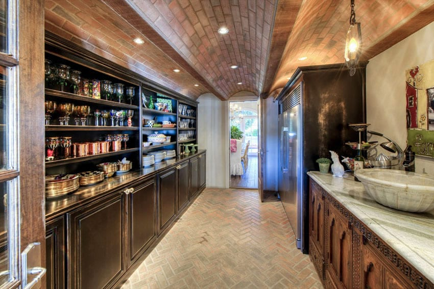 Galley kitchen with brick vaulted ceiling