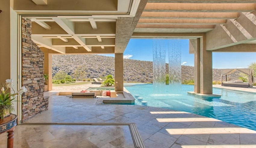 Gorgeous swimming pool with cascading waterfall water feature