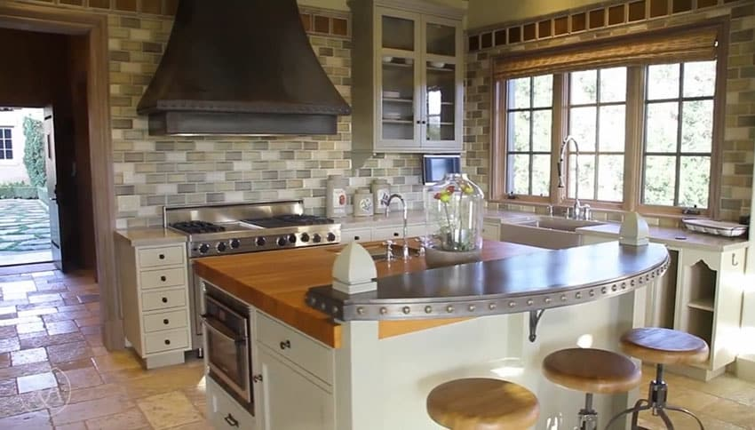 Italian style kitchen with breakfast bar and butcher block island