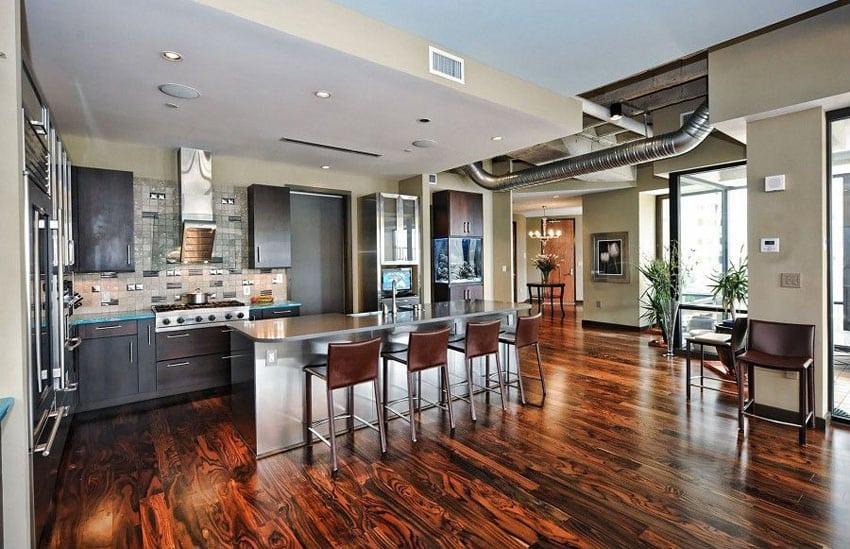 Kitchen in industrial style room with engineered hardwood floor