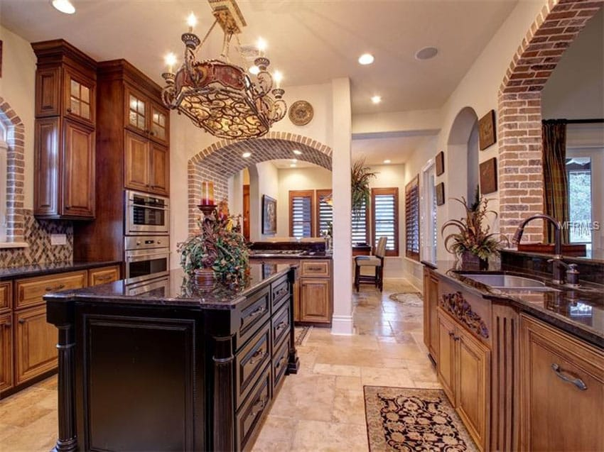 Kitchen with brick accents and dark wood island
