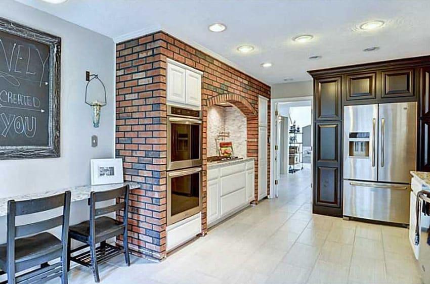 Kitchen with brick facade wall around stove