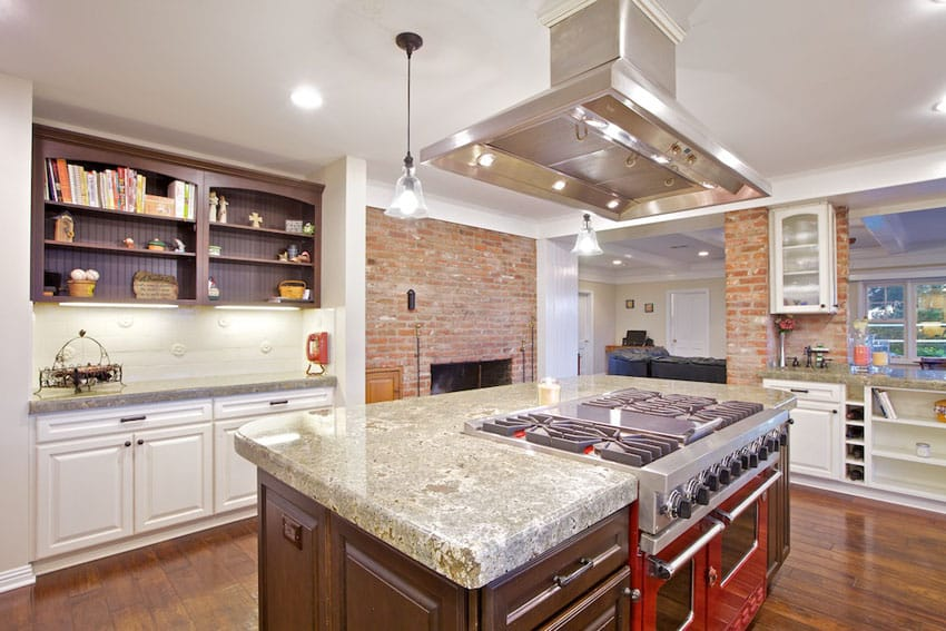 Kitchen with polished seafoam green granite counter and brick fireplace