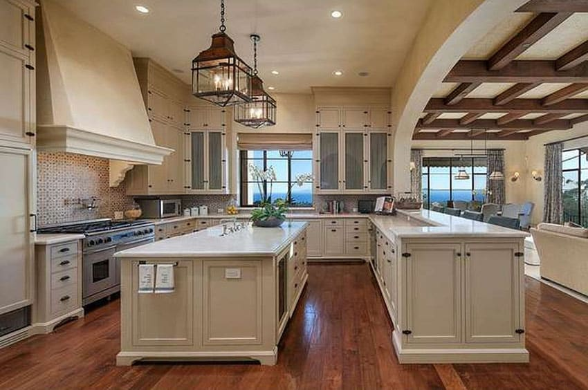 Luxury kitchen with ocean view white cabinets and hardwood floor