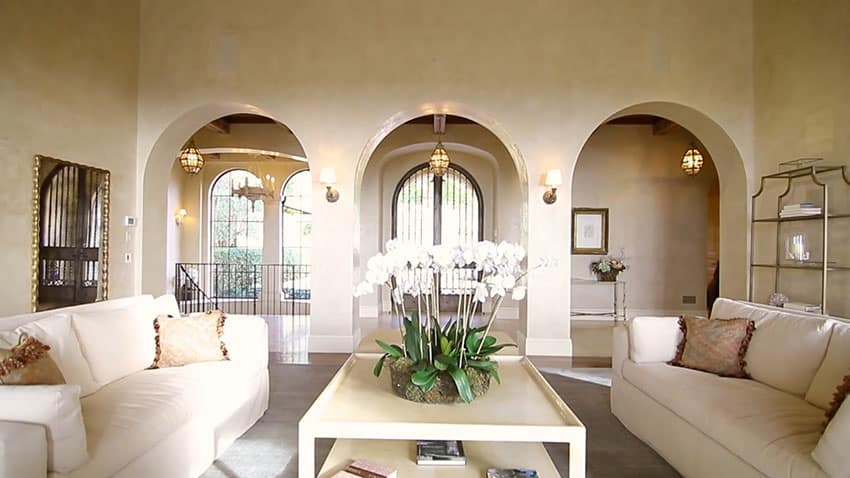 Luxury living room view to foyer entry with arches