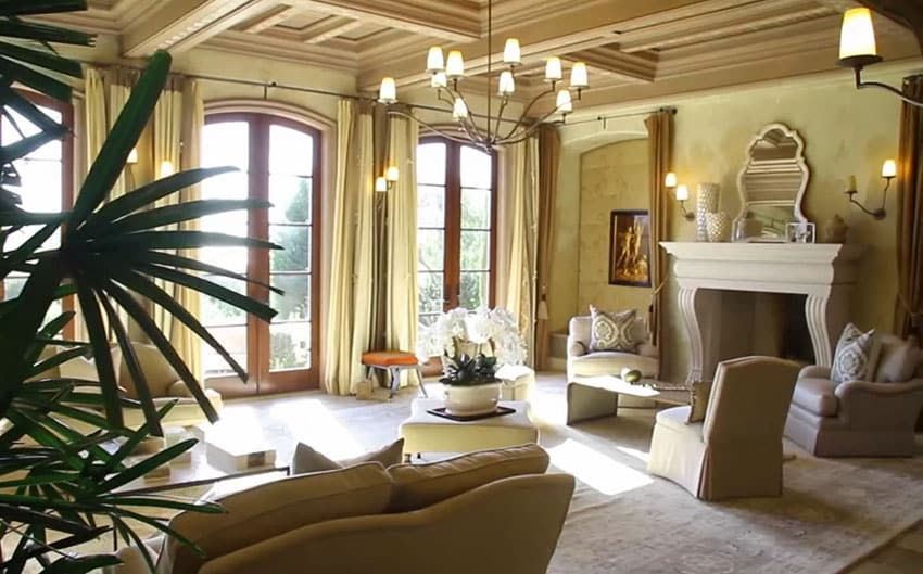 Luxury living room with coffered ceiling and fireplace