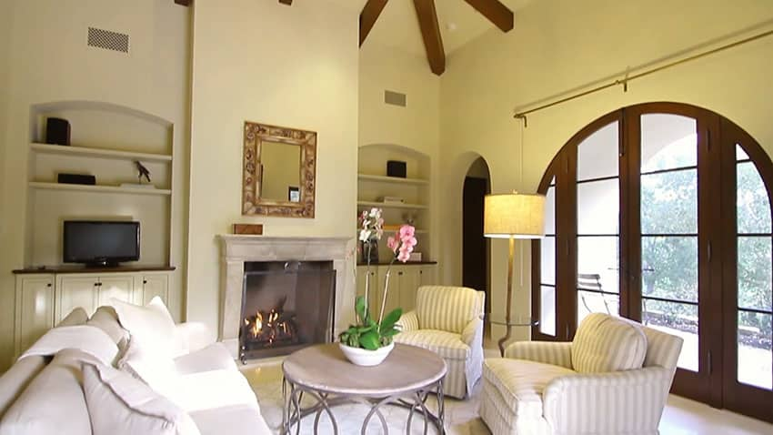 Luxury living room with exposed beam ceiling and fireplace