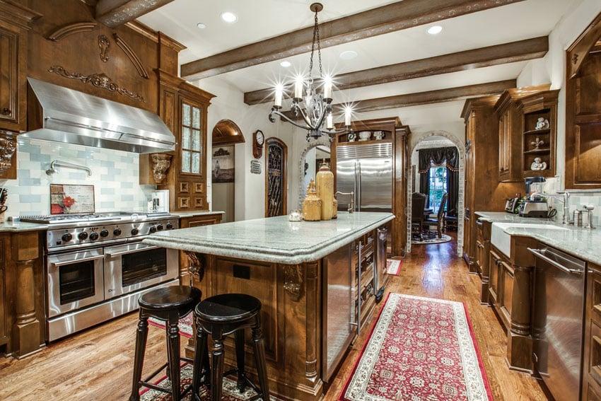 Mediterranean kitchen with green marble brick mosaic backsplash