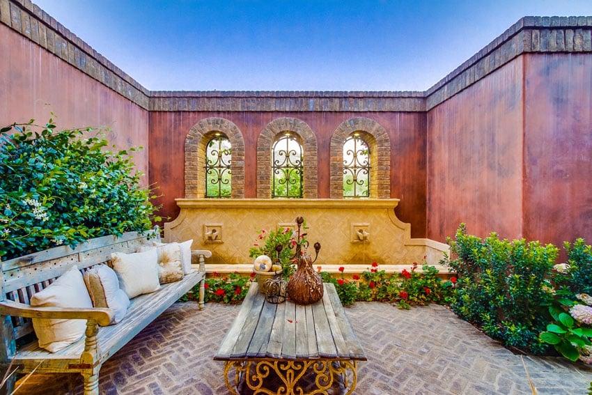 Mediterranean style patio with herringbone bricks