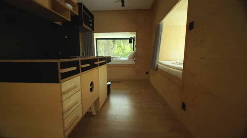 Micro apartment kitchen design with view to sleeping area
