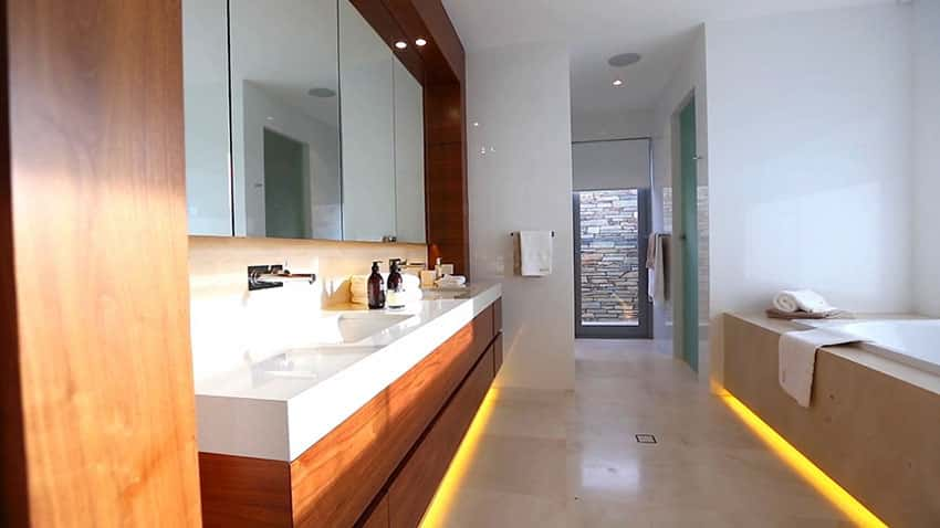 Modern bathroom with dual sinks and tub