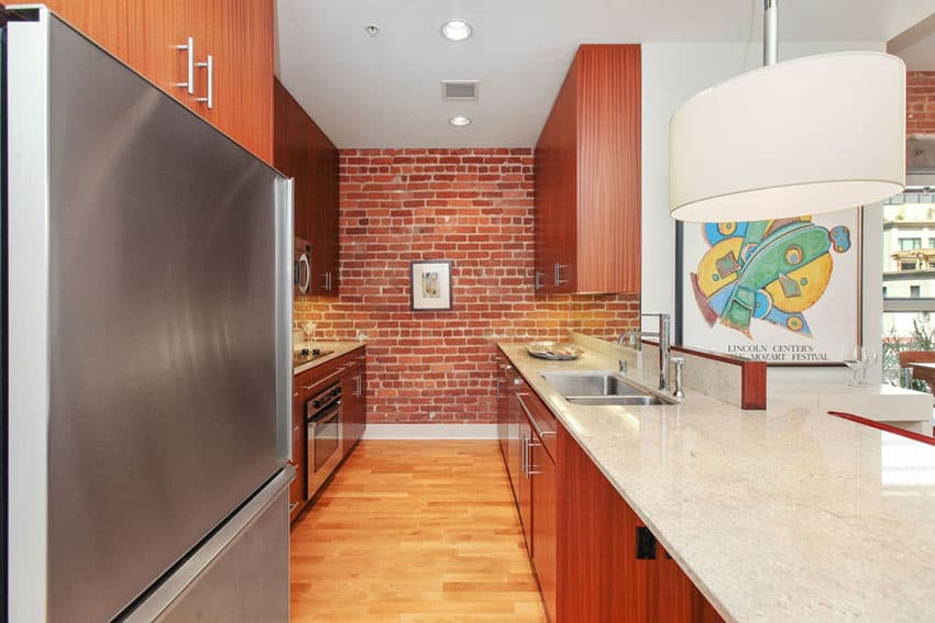Bricks Adding Texture Which Contrasts With The White Kitchen Cabinets