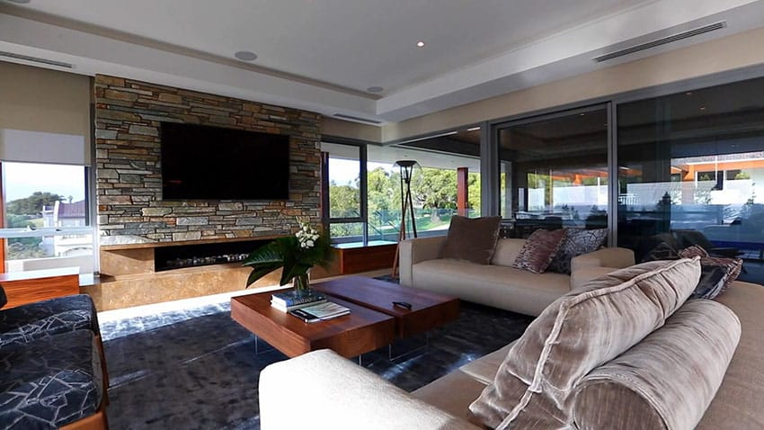 Modern living room with fireplace and stone accent wall