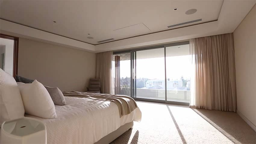 Modern minimalist master bedroom with view