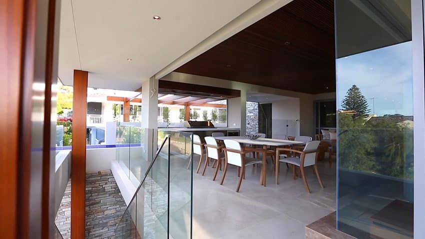 Modern patio area with glass walls