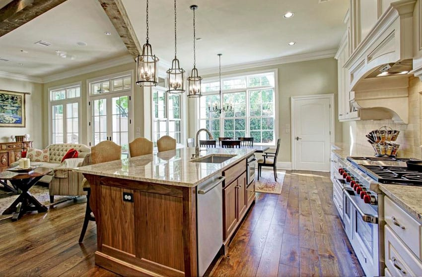 Open concept kitchen with golden crystal granite counter