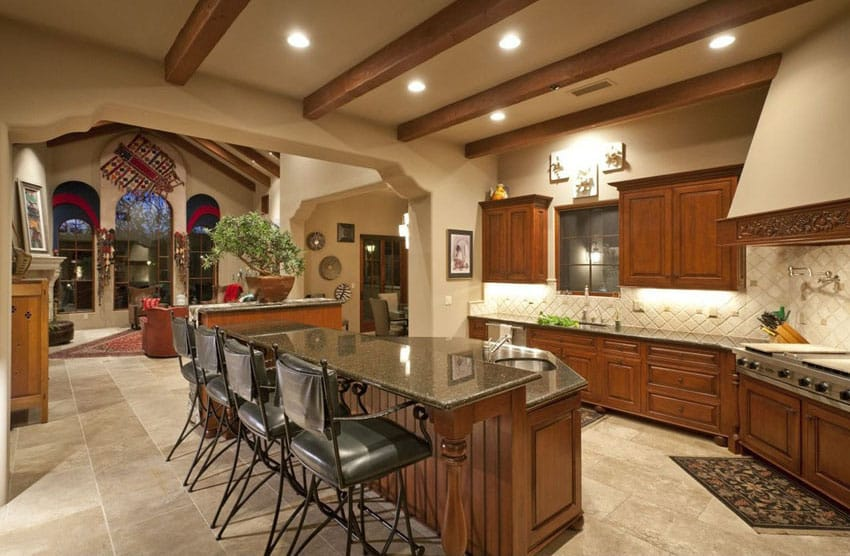 Open plan kitchen with exposed beams and breakfast bar island
