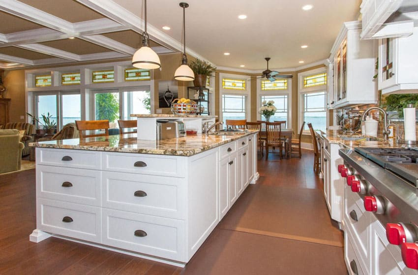 Open plan kitchen with white cabinets and traditional style