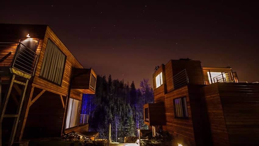 Outside micro apartments at night