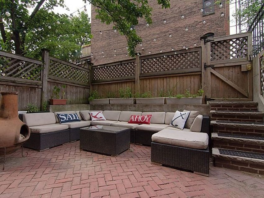 Patio with red clay paver and outdoor sectional couch