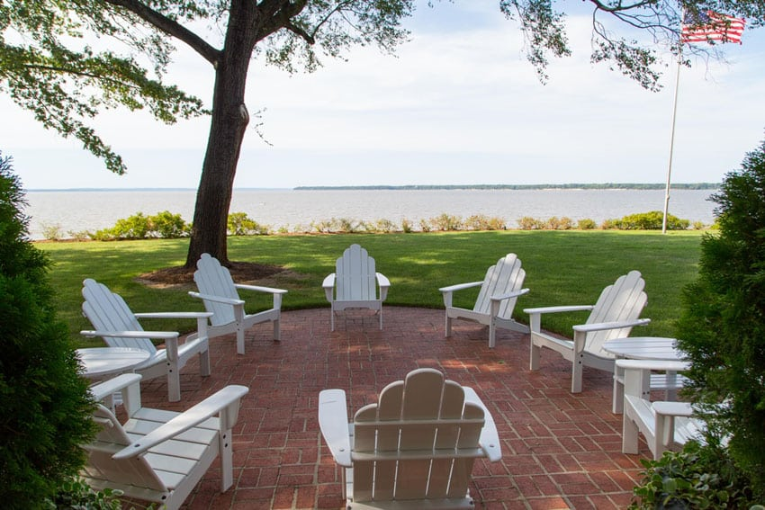 Rounded brick patio with lake view