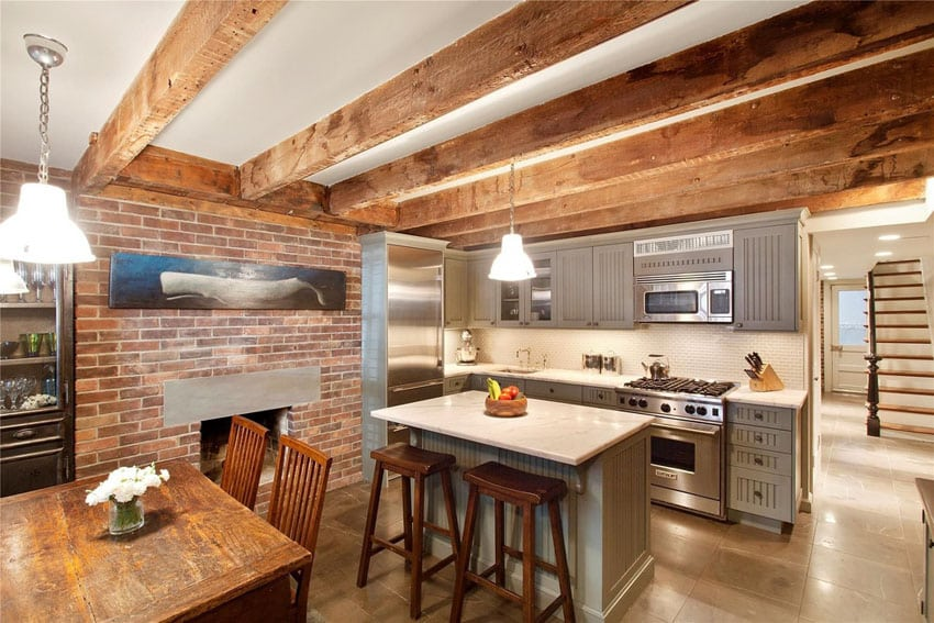 Rustic kitchen with brick fireplace and exposed beams